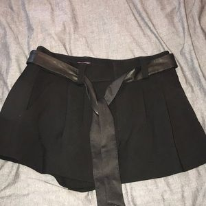 Black shorts with a leather belt